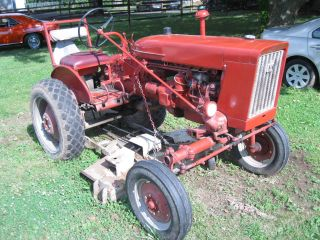 International Farmall 140 Tractor With Woods Deck photo