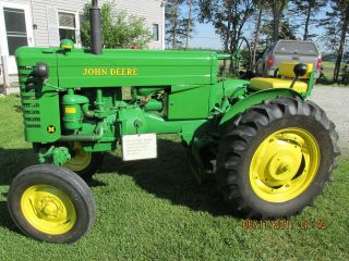 1951 John Deere M,  6 Ft.  Harrows,  6 Ft,  Spring Tooth,  2 Bottom Plows,  Fr Weight photo
