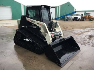 Terex Skid Steer Pt 75.  25 Hrs photo