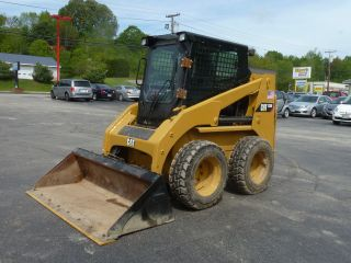 1999 Caterpillar 226 Skid Steer photo