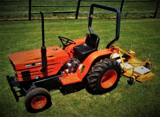 Kubota Tractor And Woods Finish Mower - photo