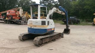 Komatsu Pc38uu Mini Excavator Backhoe W/dozer Blade photo