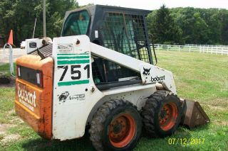 Bobcat 751 Loader / 60 Inch Smooth Bucket photo